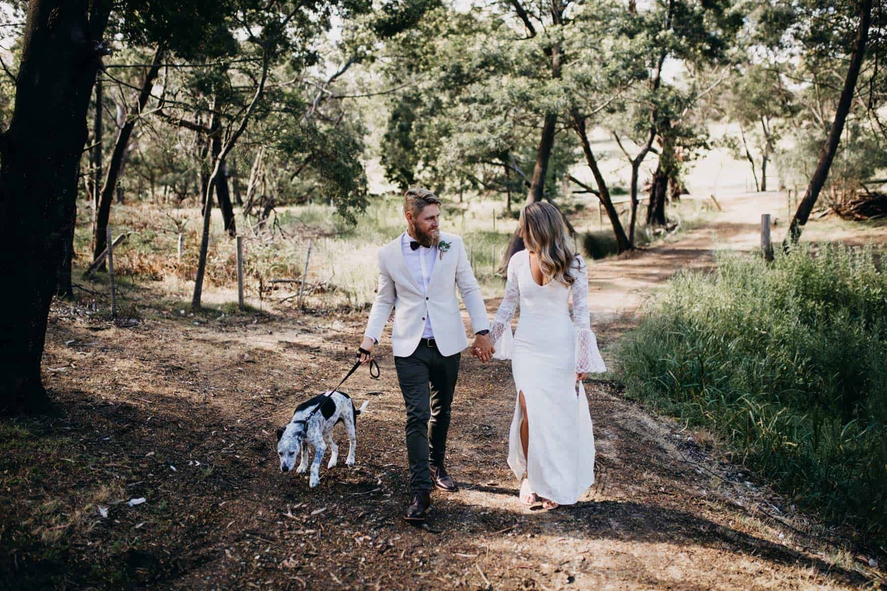boho wedding with puppy in bow tie