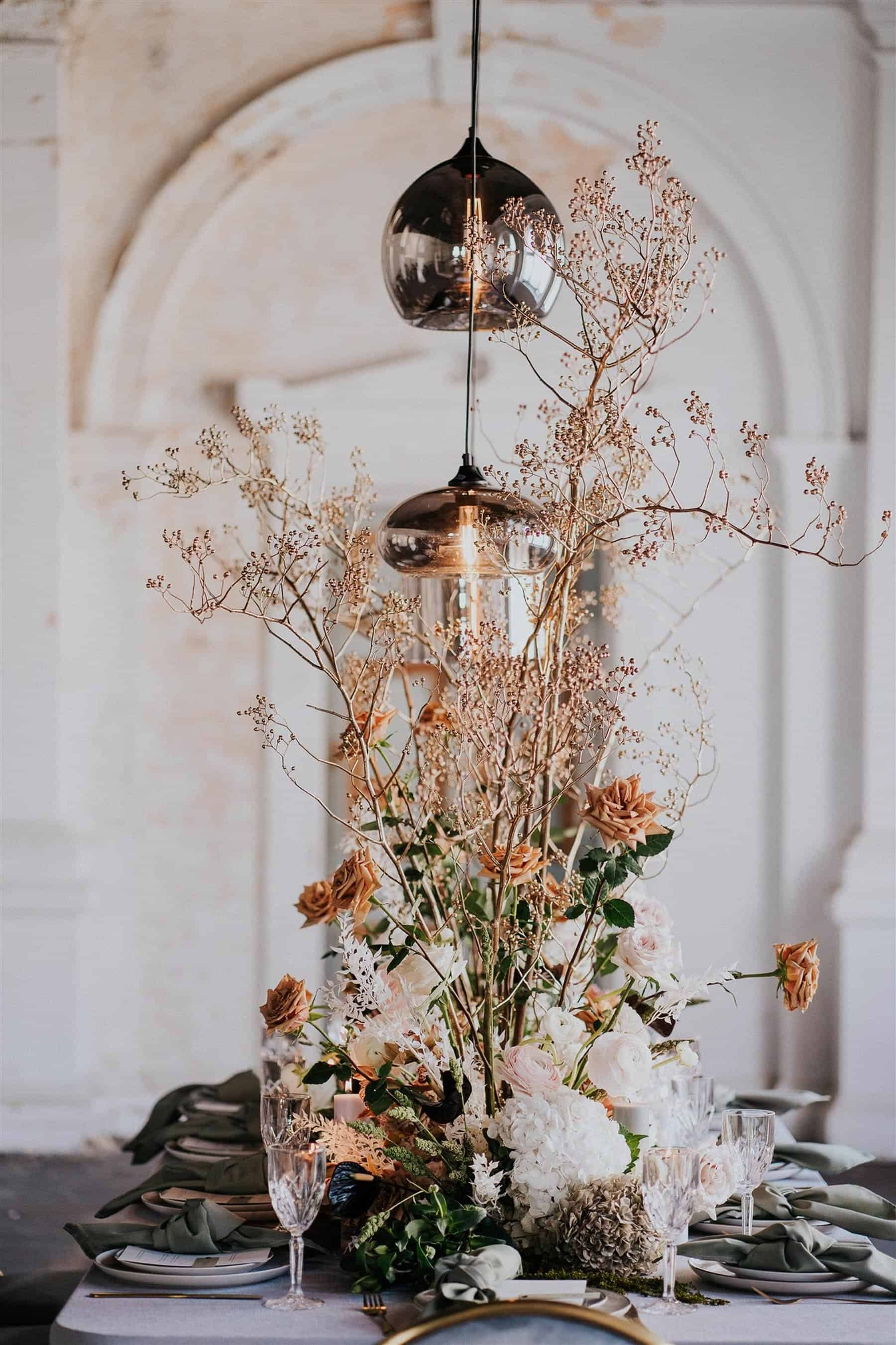 floral tablescape with hanging pendant lights