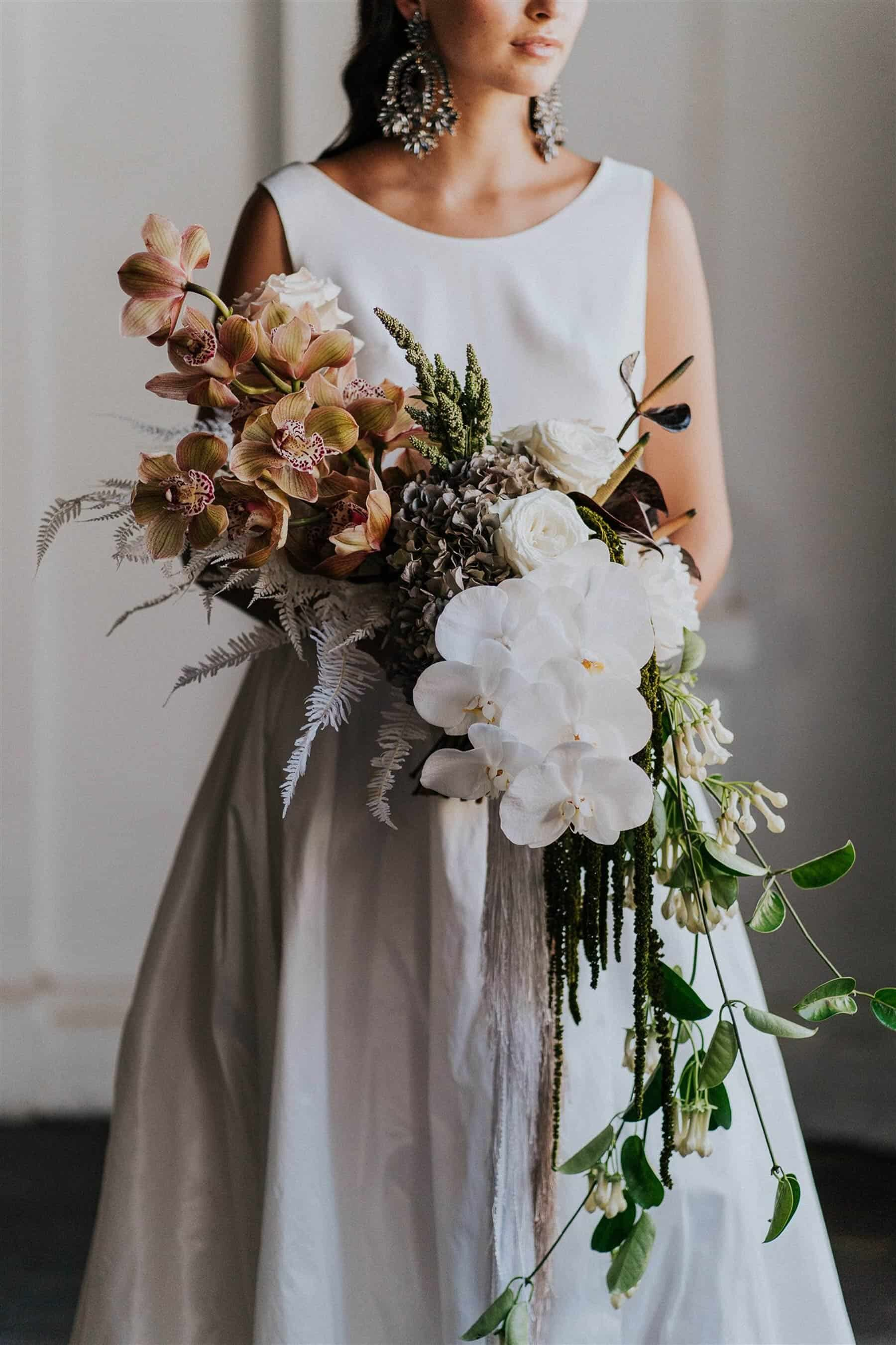 modern cascading bridal bouquet with orchids