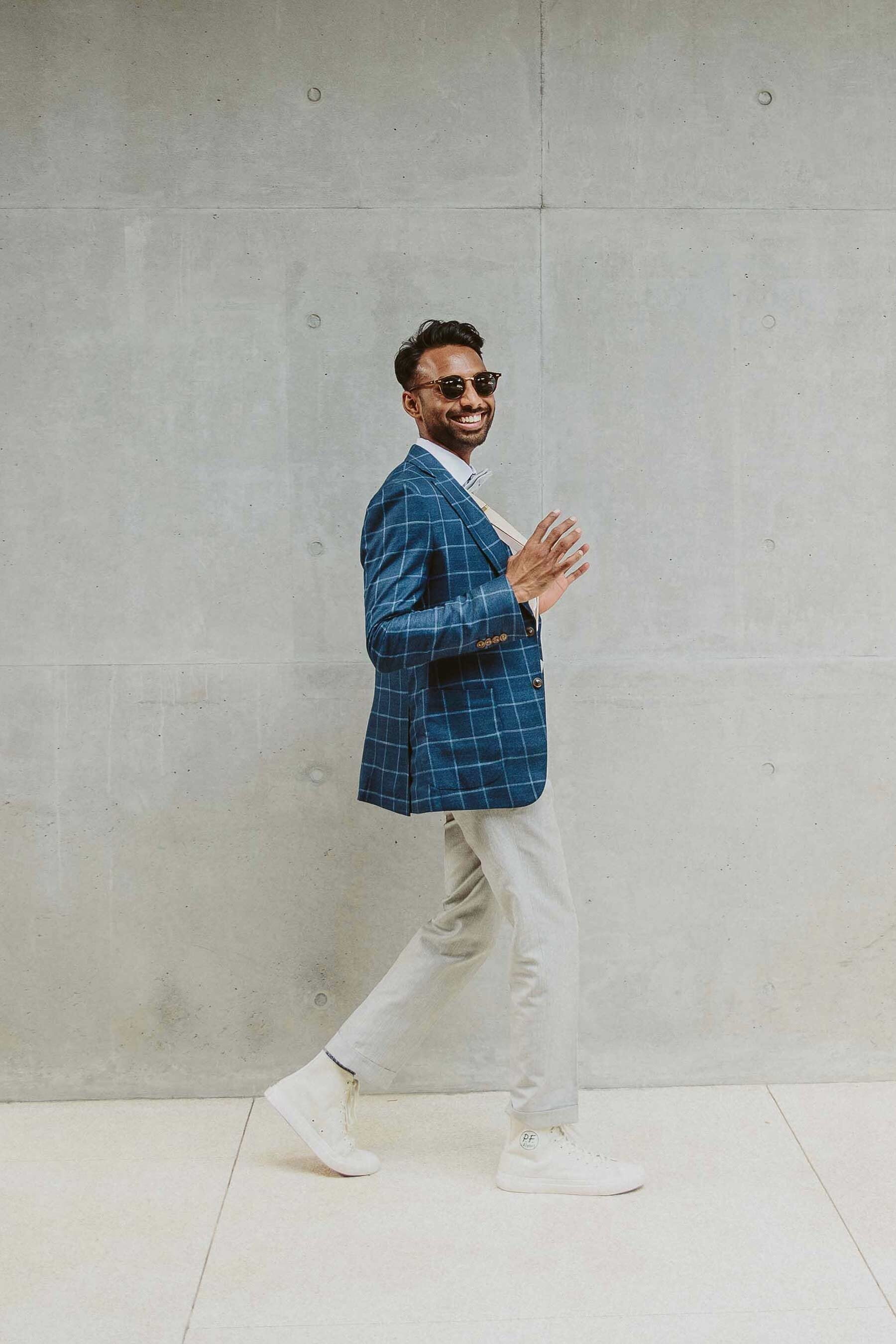 Stylish groom in chinos and checkered blue blazer