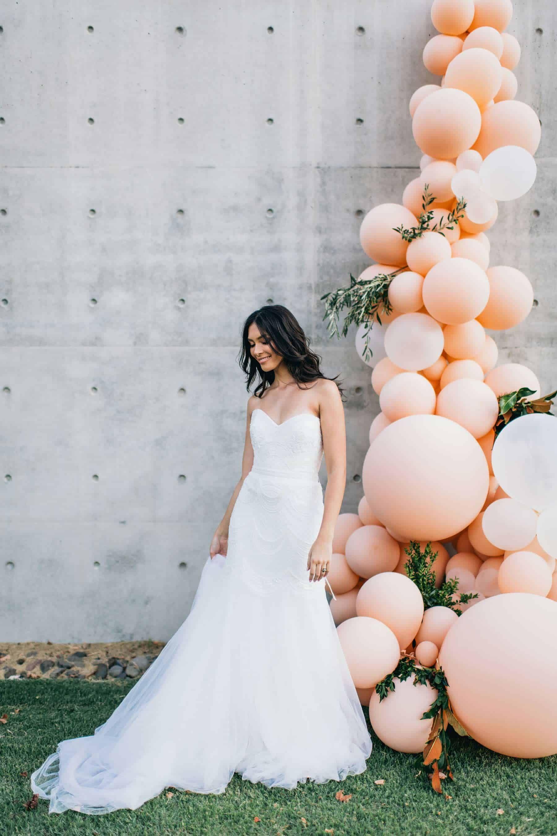 modern bride with pastel pink balloon installation