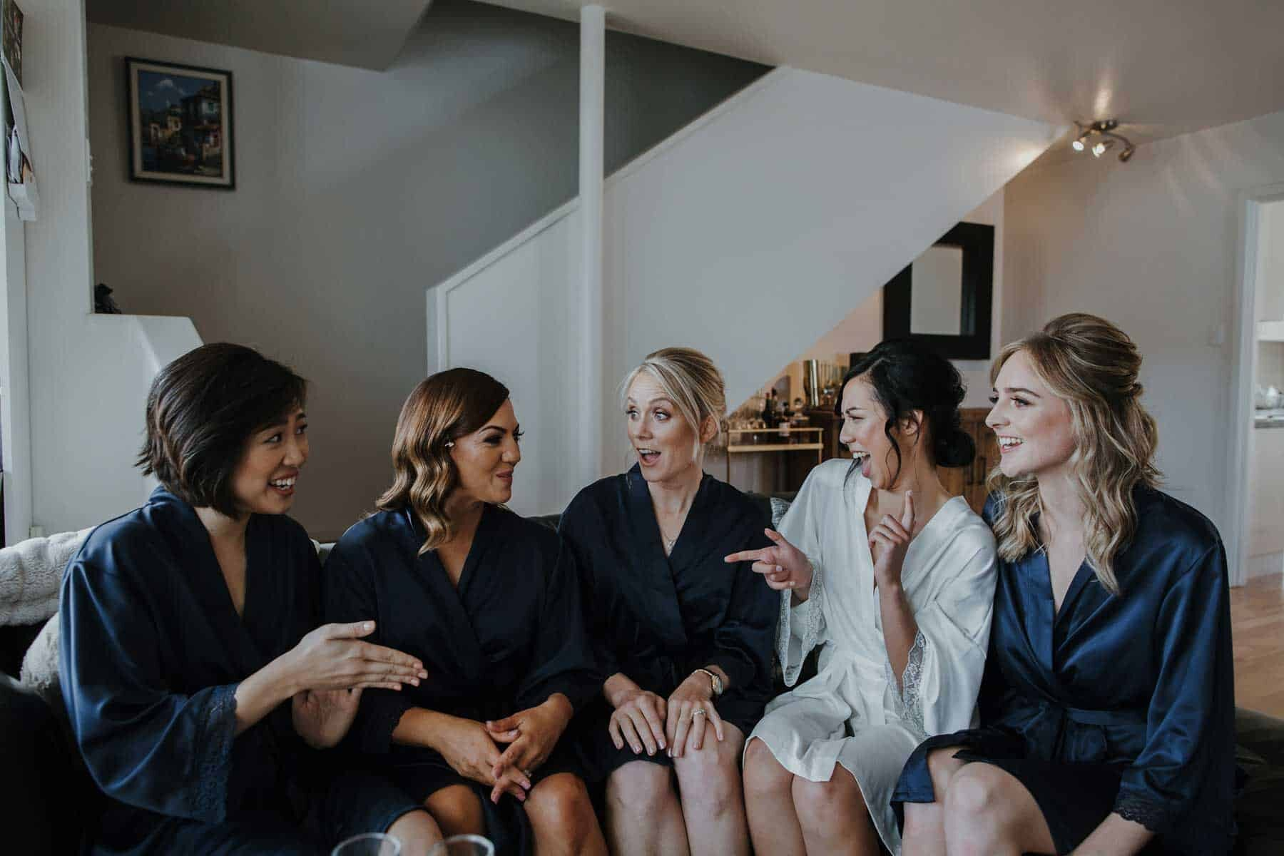 bridesmaids getting ready in silk robes