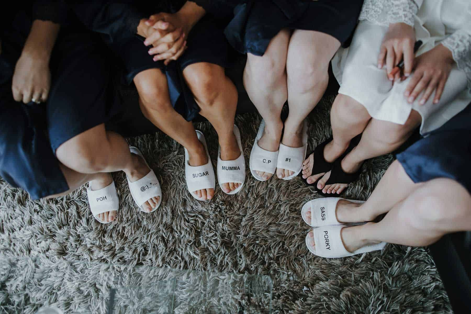 bridesmaids getting ready with personalised slippers