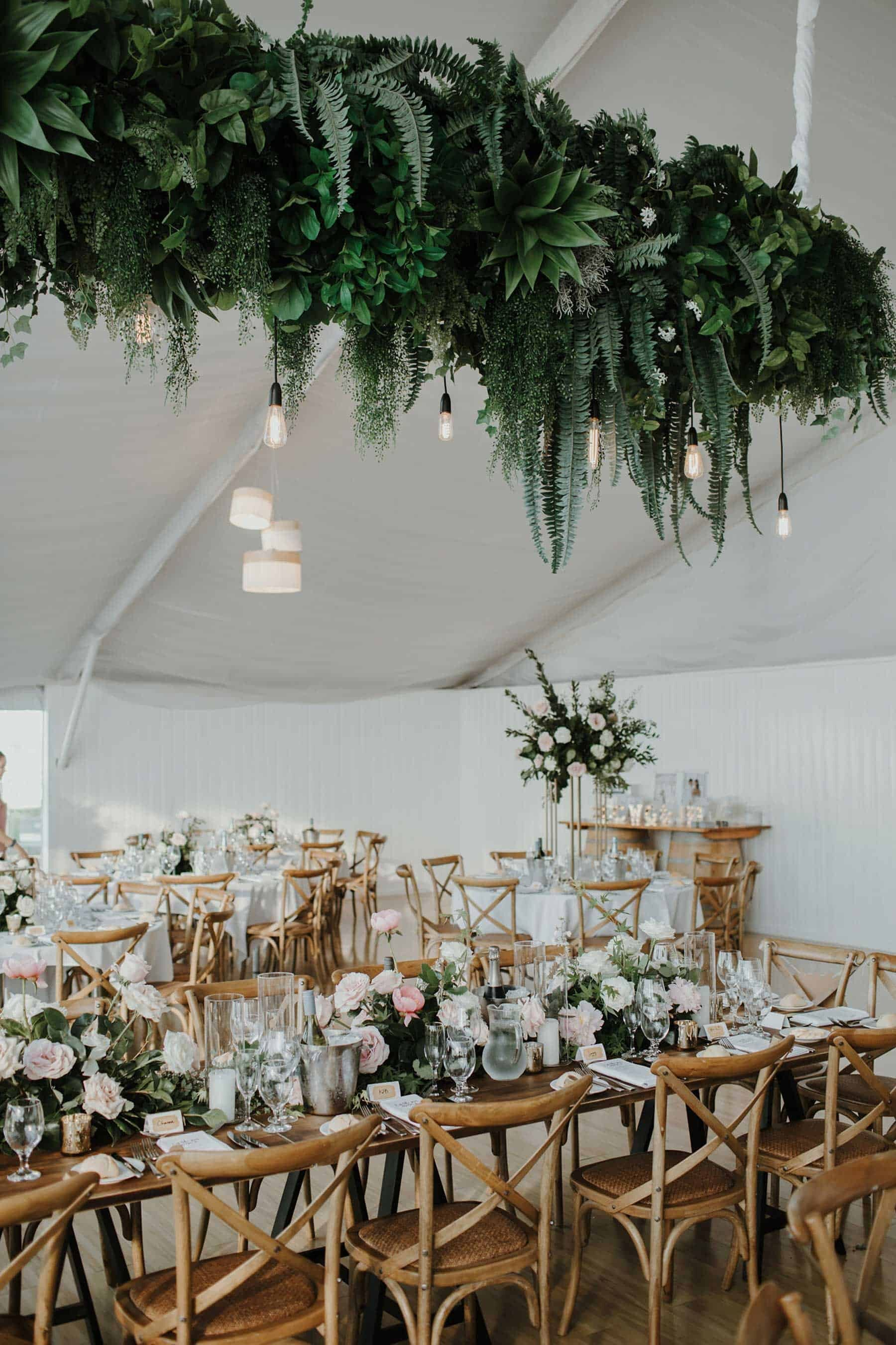 modern marquee wedding with hanging foliage installation