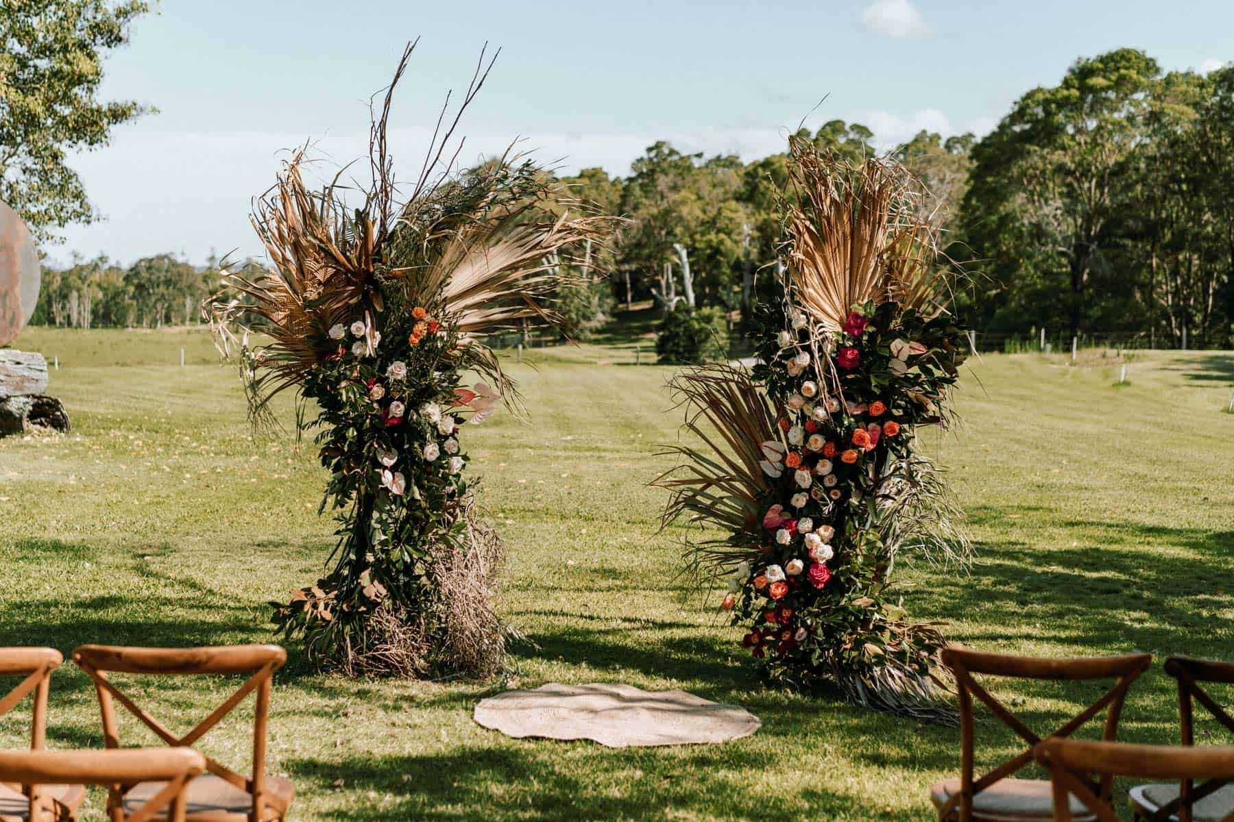 floral arch with dried palm leaves