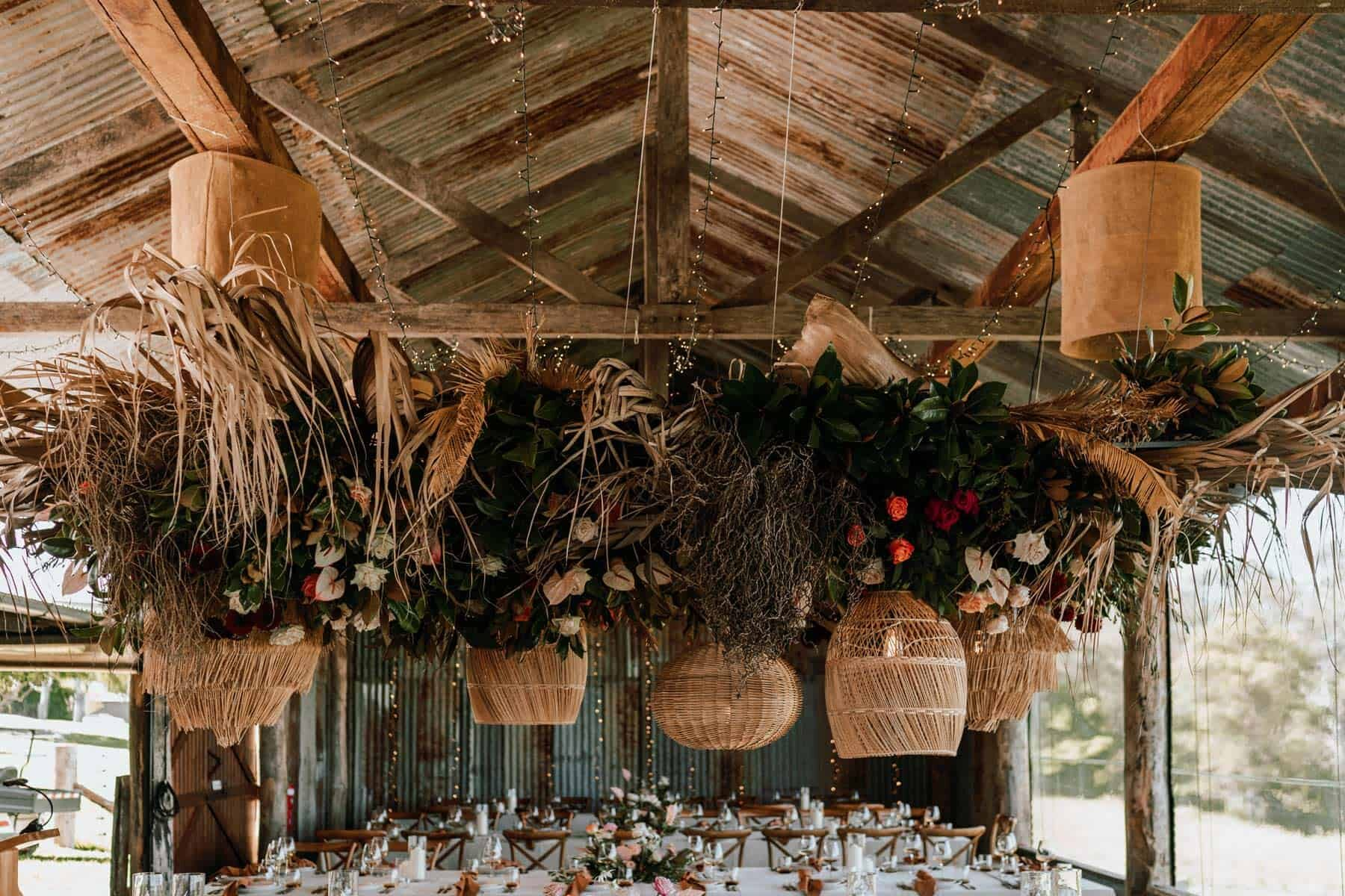 hanging floral installation with cane lanterns