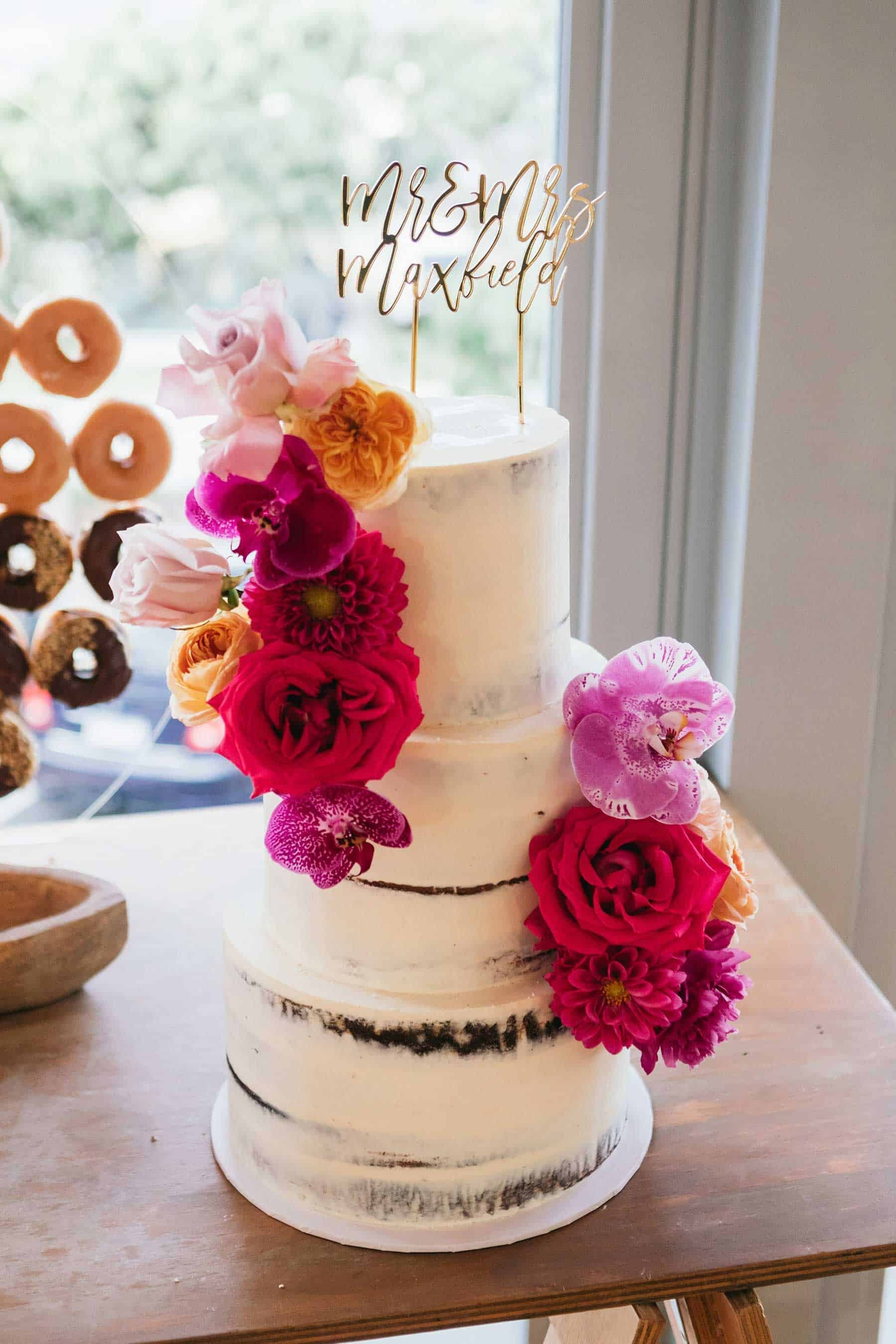modern wedding cake with bright pink flowers