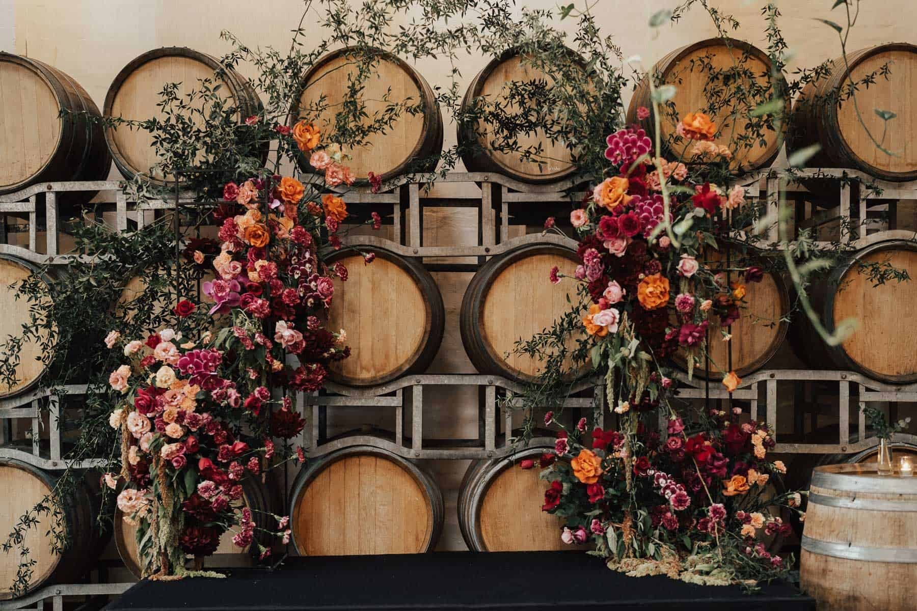 orange and pink floral arch wedding backdrop