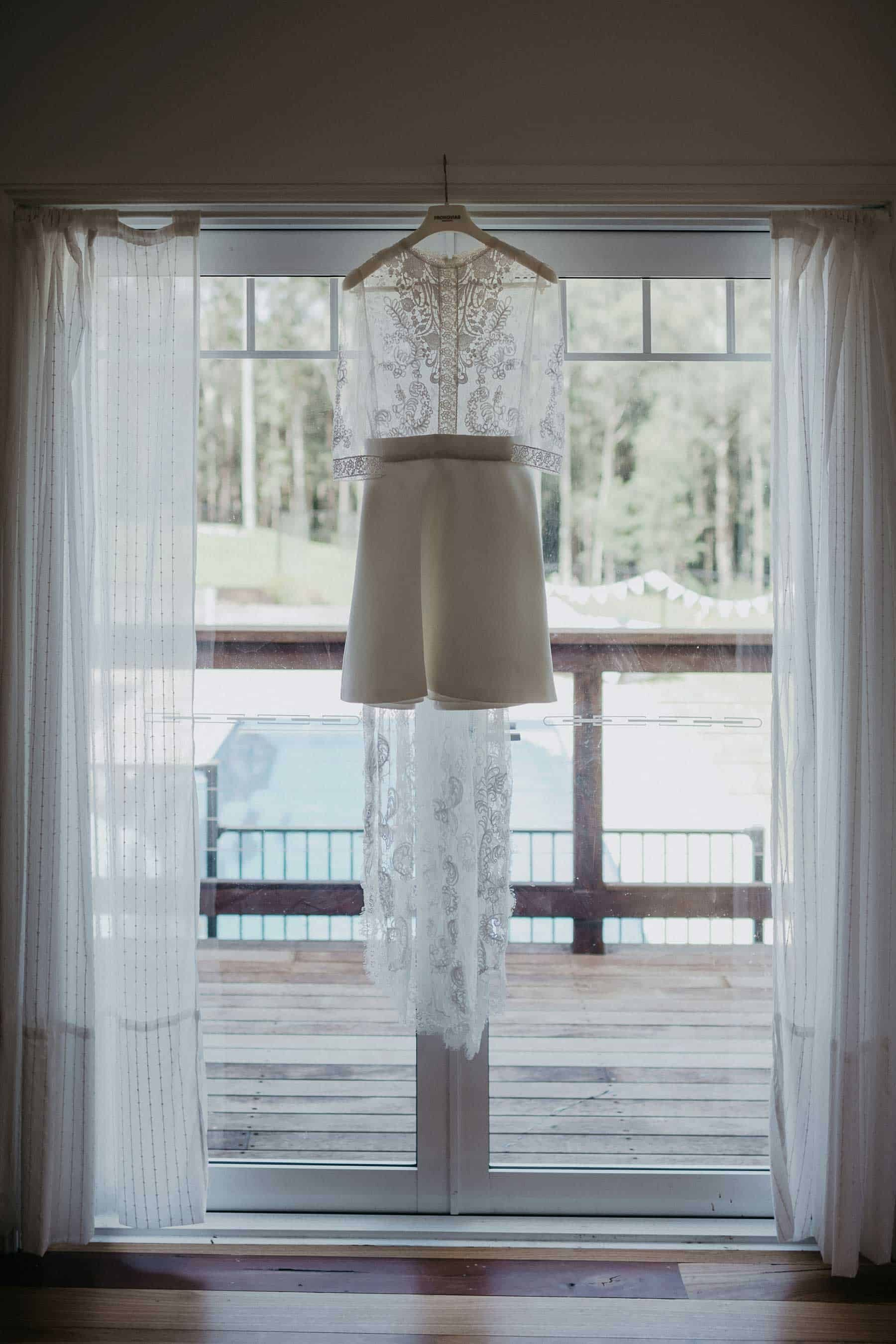 short wedding dress with lace bodice and long sleeves
