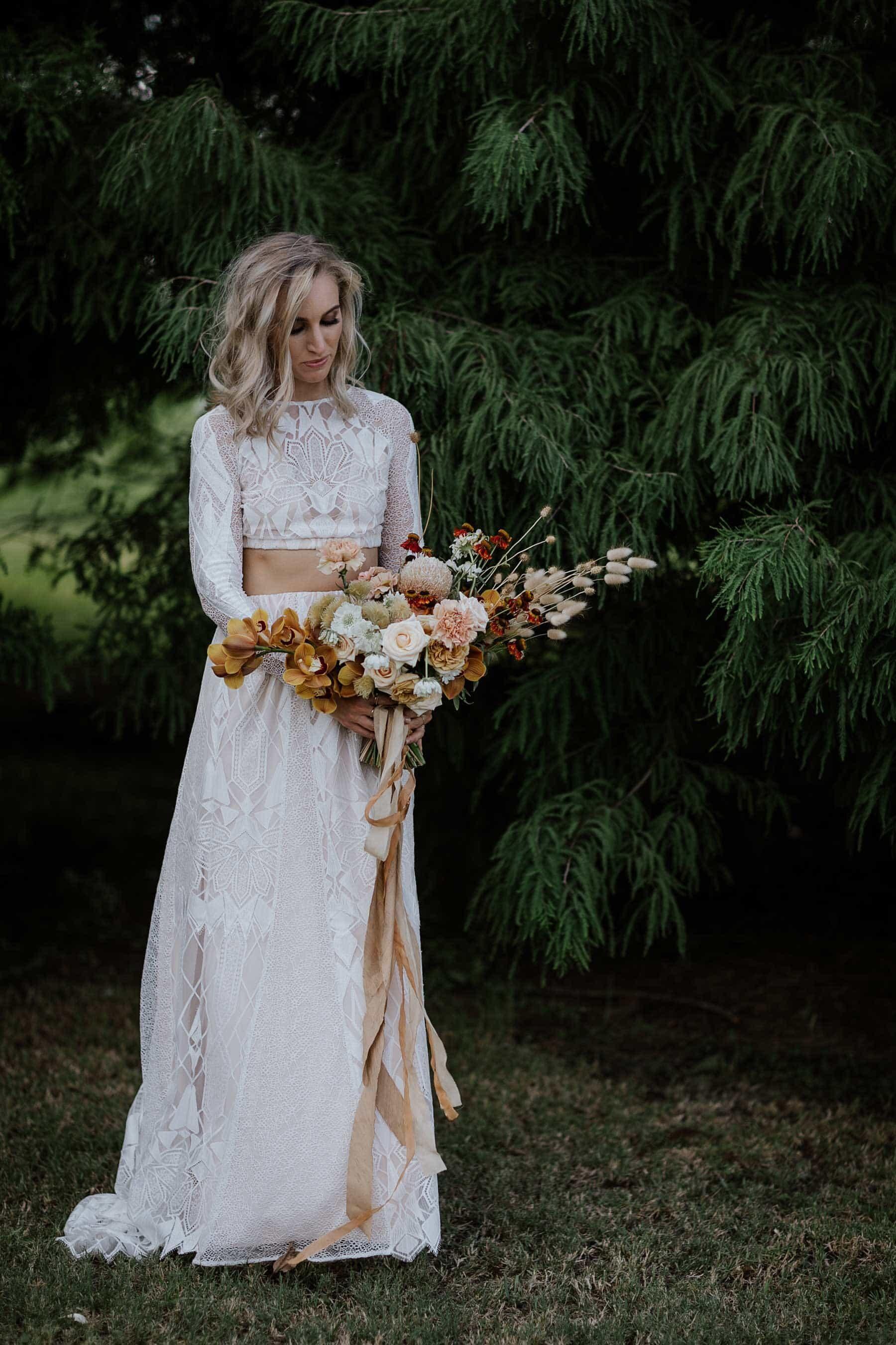 boho bride in two-piece long sleeve wedding dress