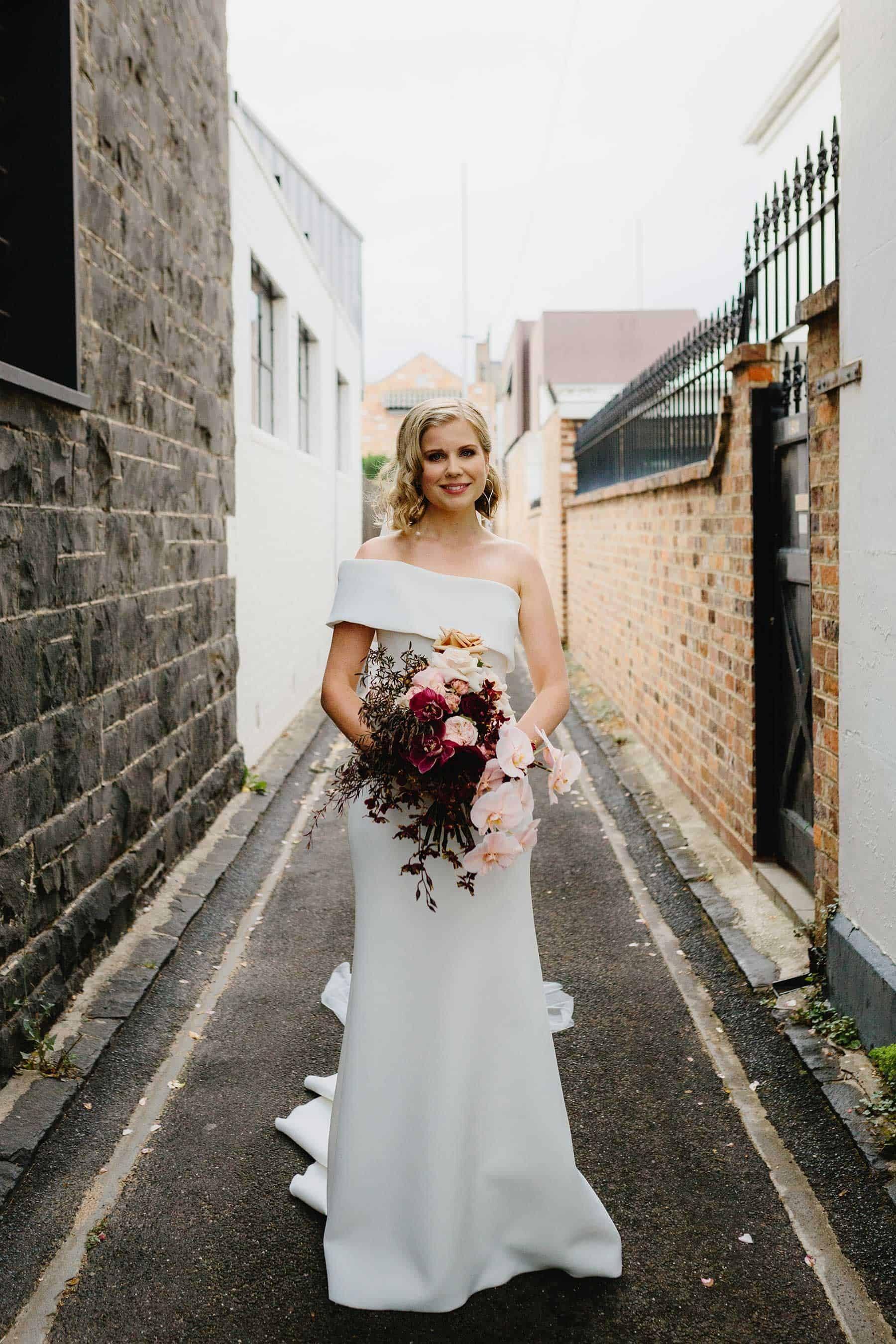 simple off-shoulder wedding dress by Chosen