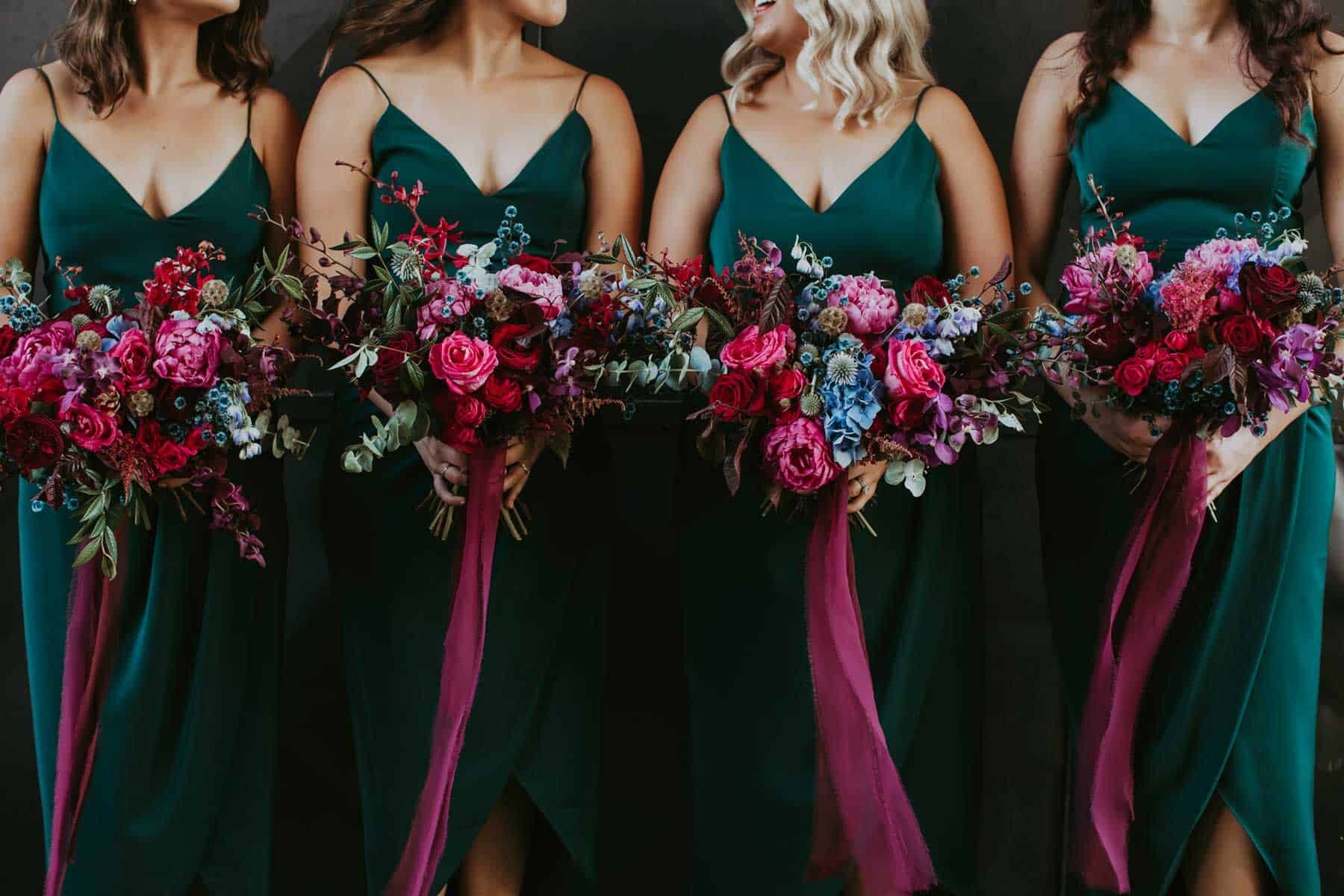 emerald green bridesmaid dresses and pink bouquets