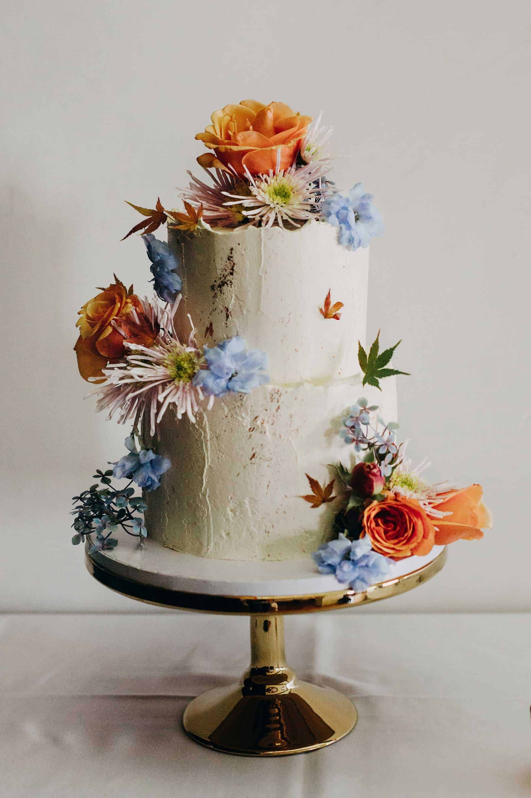 simple rustic wedding cake with fresh flowers