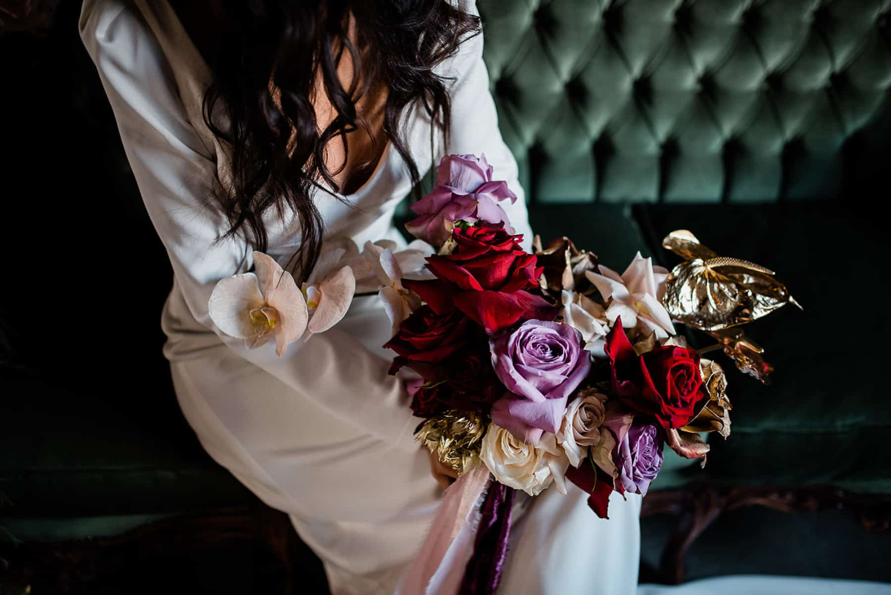 moody bridal bouquet with gold leaves
