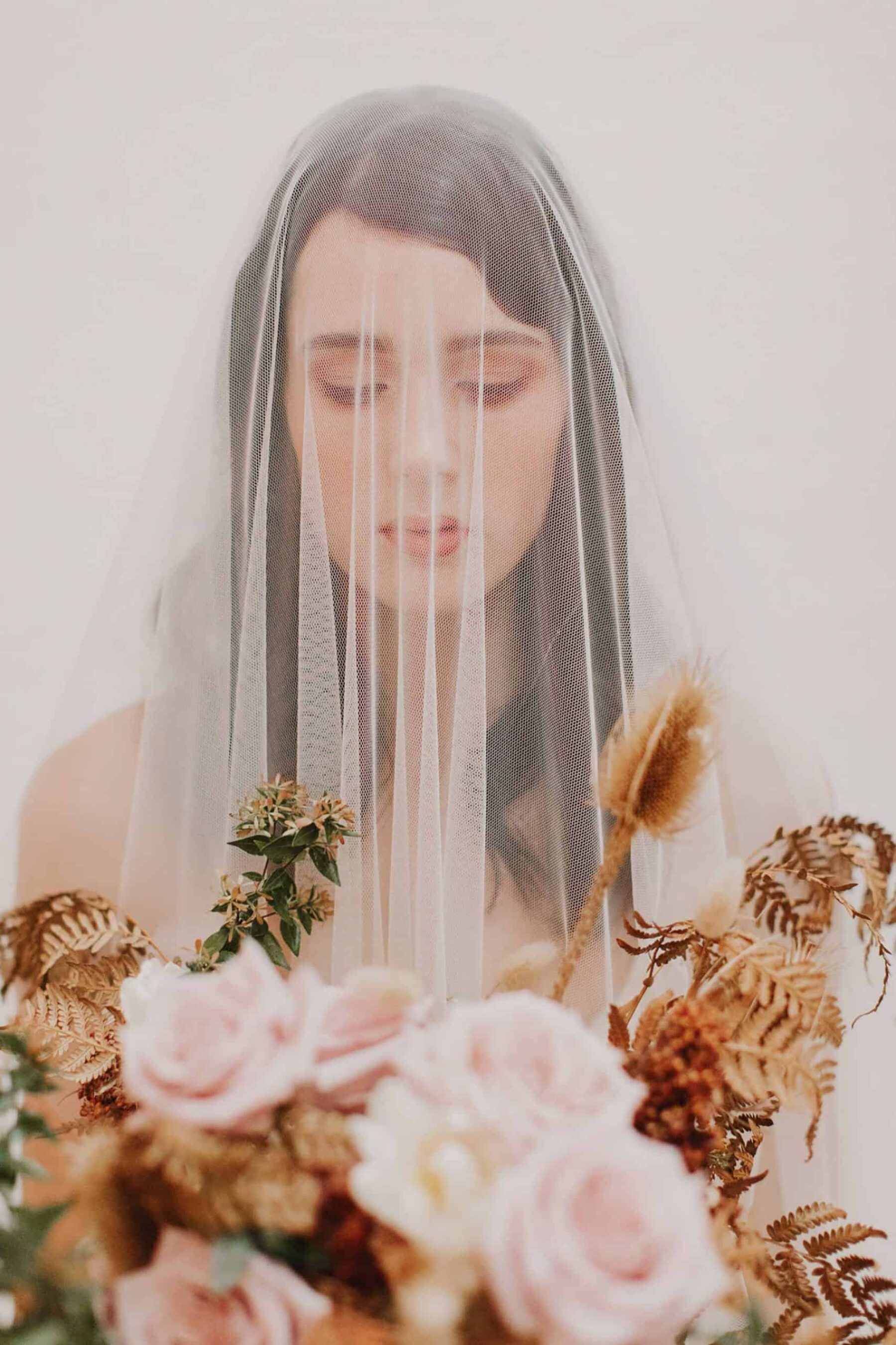 ethereal bride with blush bouquet