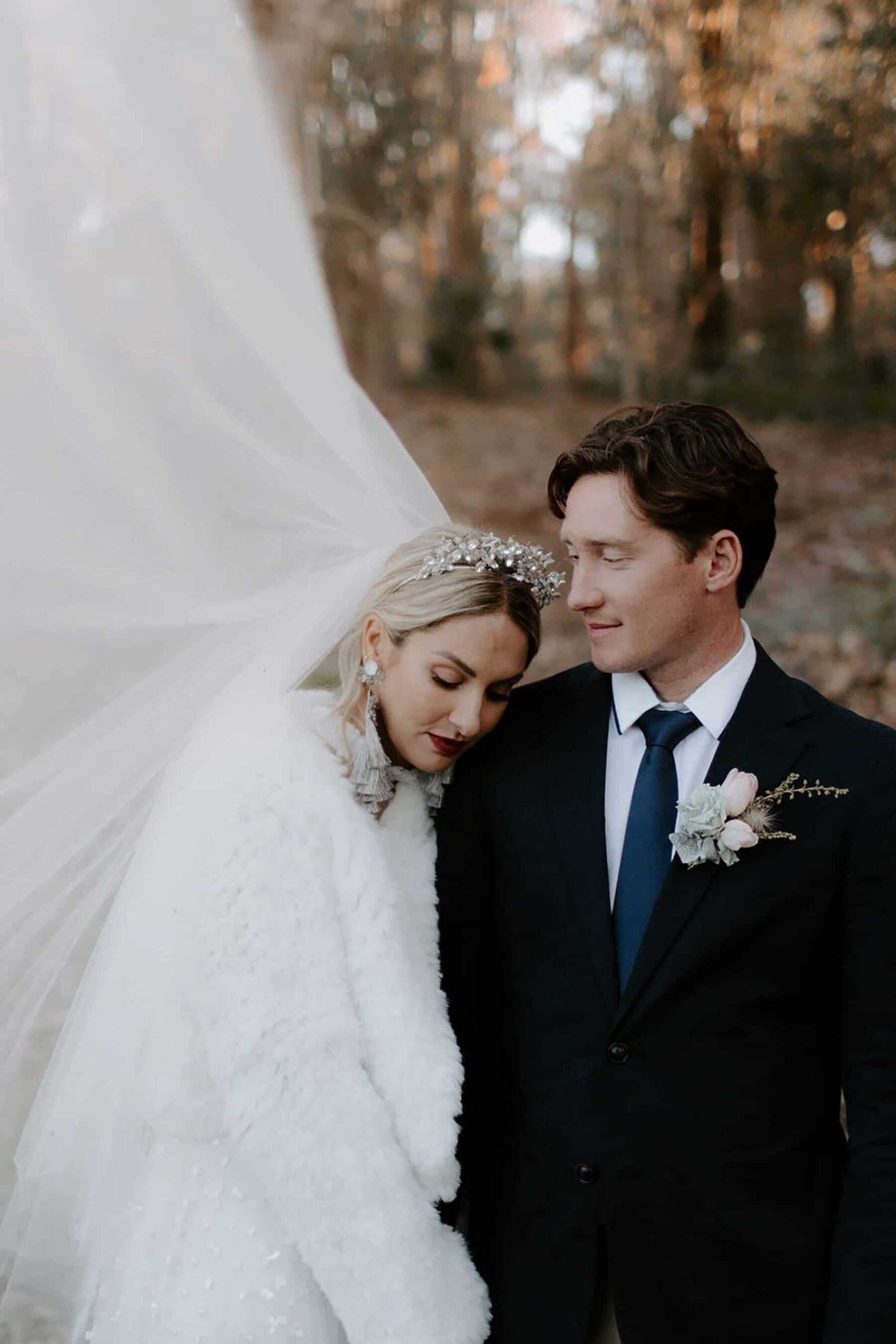 winter bride with faux fur coat and golden crown